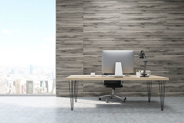 CEO working desk in office with wooden panels - Photo