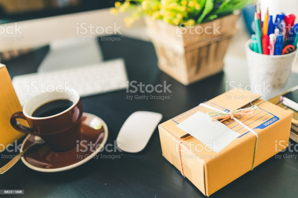 Working desk of home business startup. SME e-commerce packaging delivery, online marketing, or freelance concept stock photo