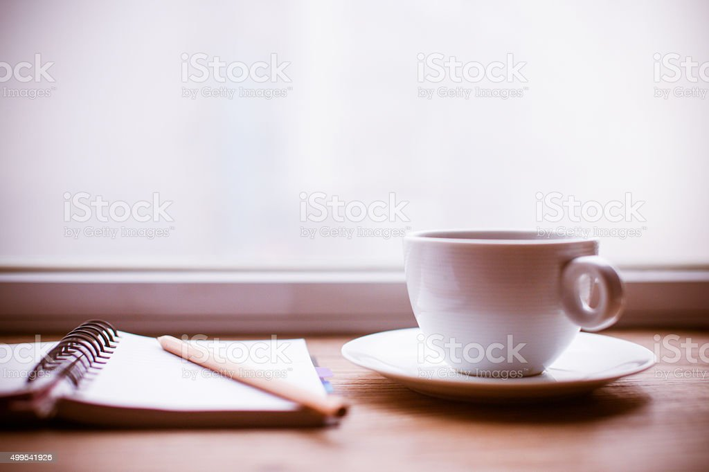 Working desk with notebook and coffee