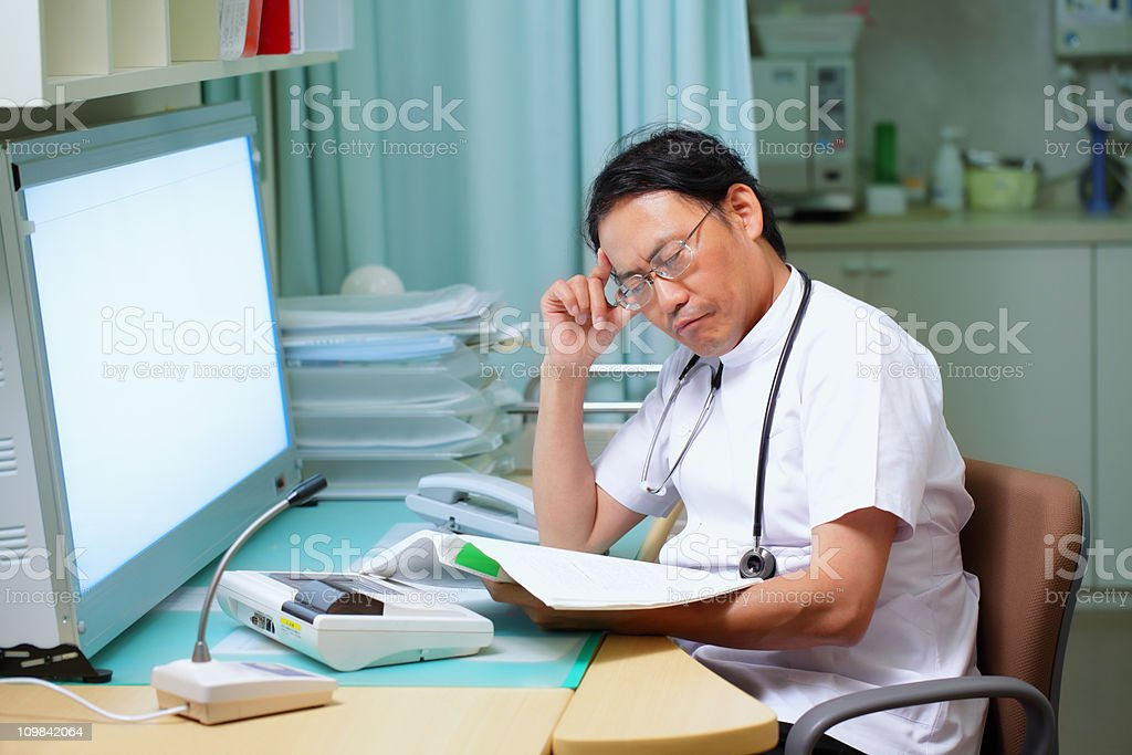Working doctor stock photo