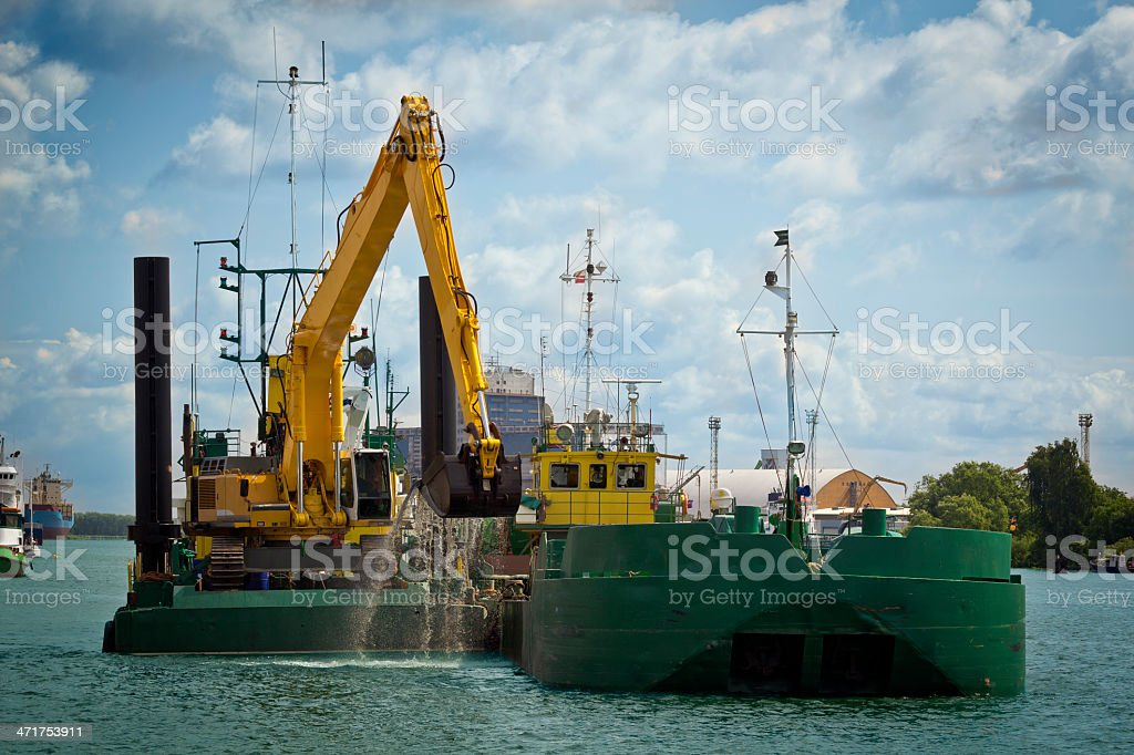 Working dredger on the water canal stock photo