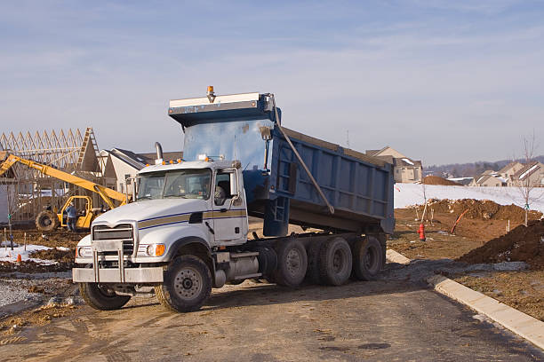 Working Dump Truck on Contstruction Site stock photo