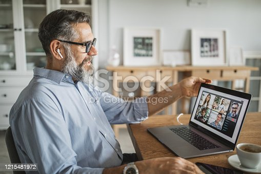 Mature men at home during pandemic isolation have conference  call
