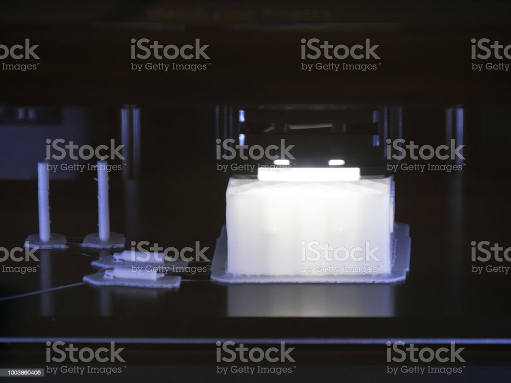 Working Electronic three dimensional plastic printer, 3D printing stock photo