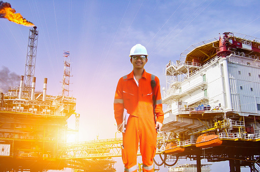 Working Engineer At Offshore Oil And Gas Refinery Stock Photo & More