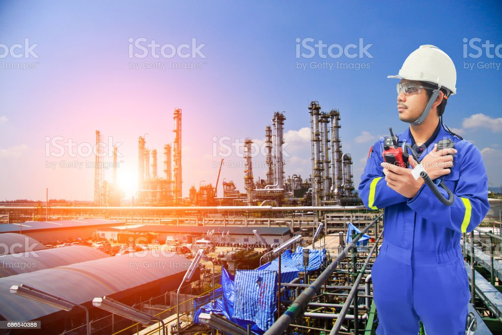 Working engineer at petrochemical oil and gas refinery zbiór zdjęć royalty-free