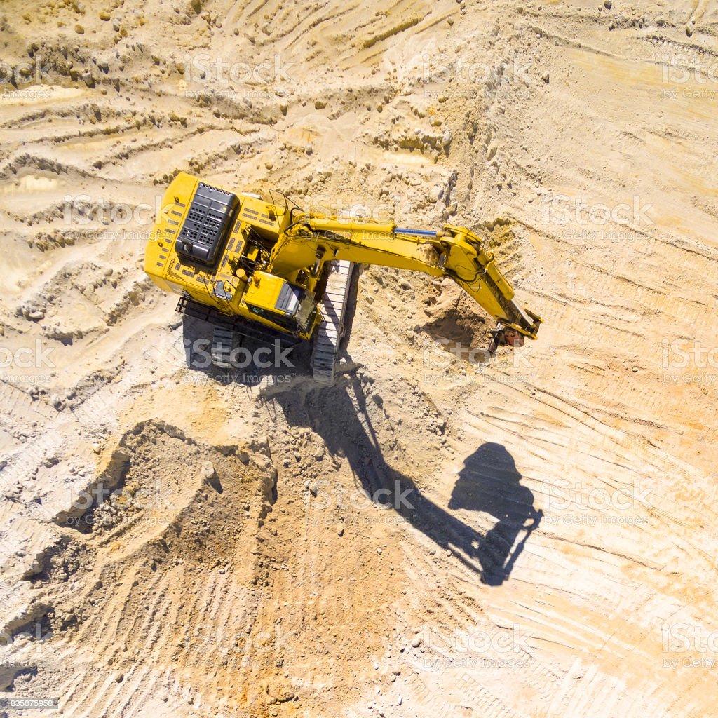 Working excavator in the mine. stock photo