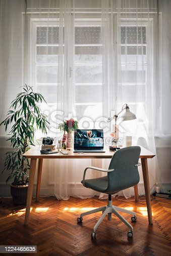 Social distancing: the cosy workplace of a businesswoman working from home.