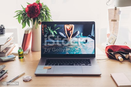 Social distancing: a messy desk of a businesswoman working from home.