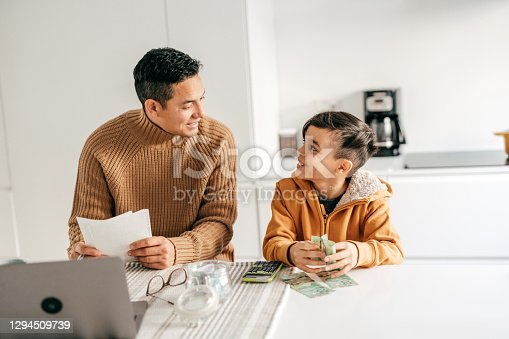 istock Working from home and homeschooling with elementary age child 1294509739