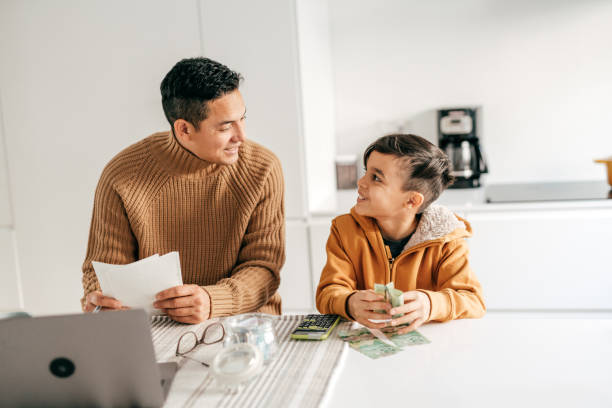 Working from home and homeschooling with elementary age child stock photo