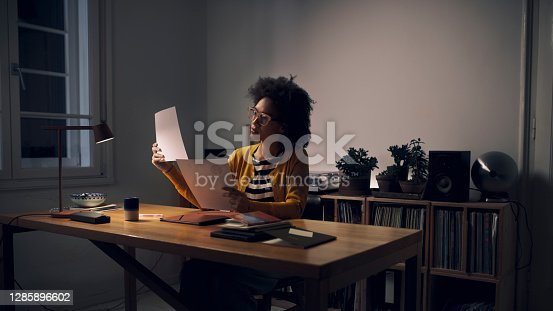 Beautiful young mixed race businesswoman adapting to the new normal by working at her home office desk.
