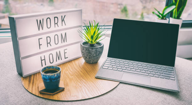 Working from home remote work inspirational social media lightbox message board next to laptop and coffee cup for COVID-19 quarantine closure of all businesses stock photo