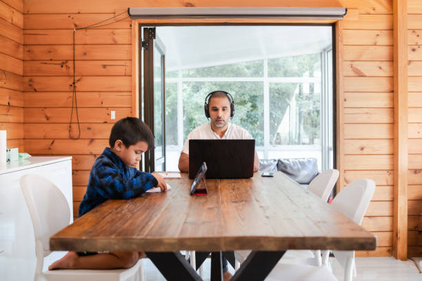 Working from home with kids. stock photo