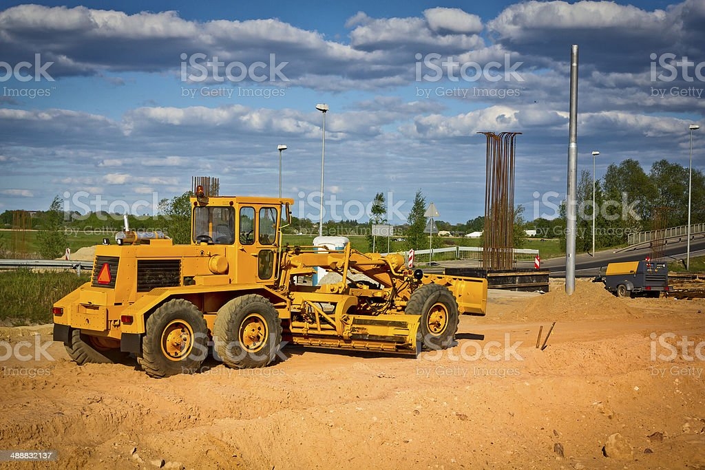 Working Grader at a new highway construction stock photo