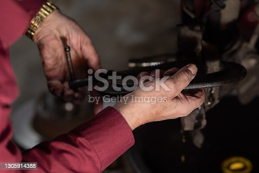 istock Working Greasy hands on old car, DIY stock photo 1305914388