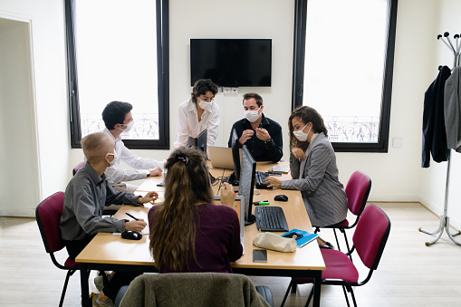 six-person task force in an office during coronavirus