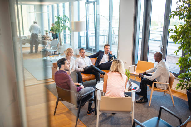 working group portrait of businesspeople in office lobby - business stock pictures, royalty-free photos & images