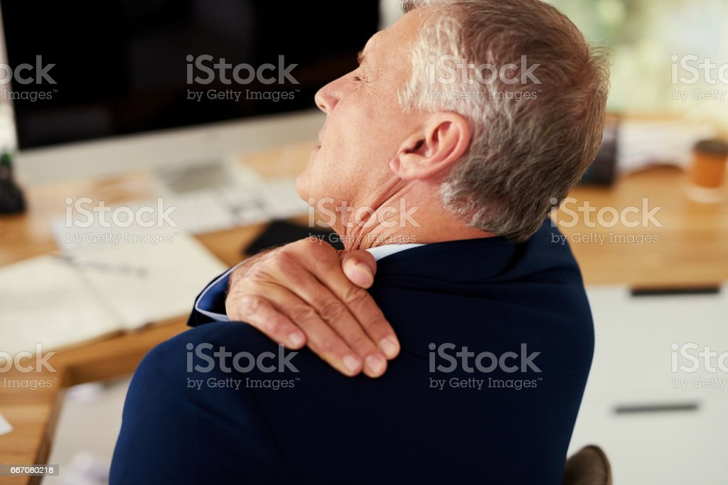 Working hard can come with its own aches and pains stock photo