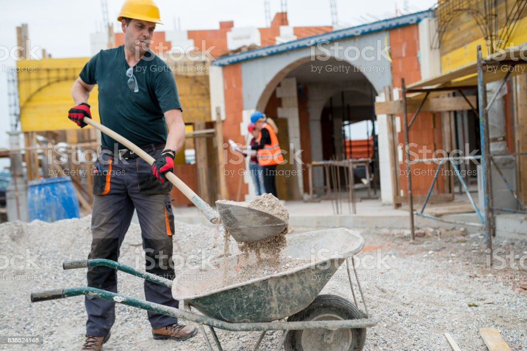 Working hard on construction site stock photo