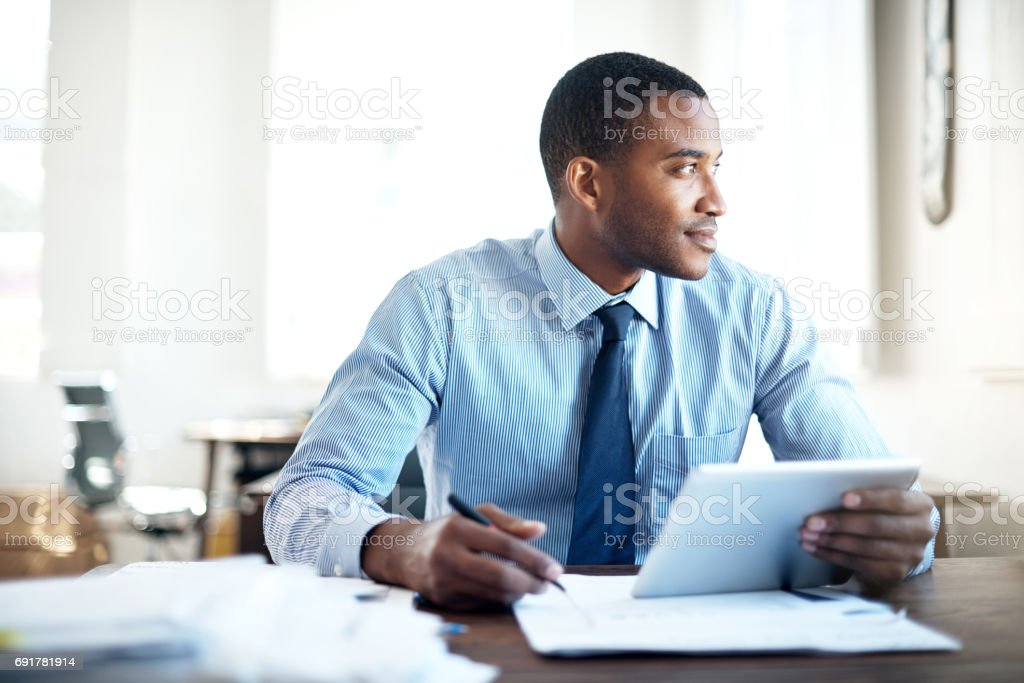 Working hard to fulfil his ambition of succeeding big stock photo