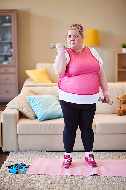 working hard to get fit - funny fat lady stock photos and pictures