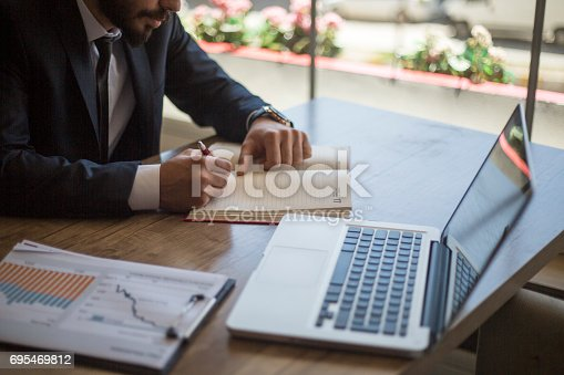 istock Working hard to grow his business 695469812
