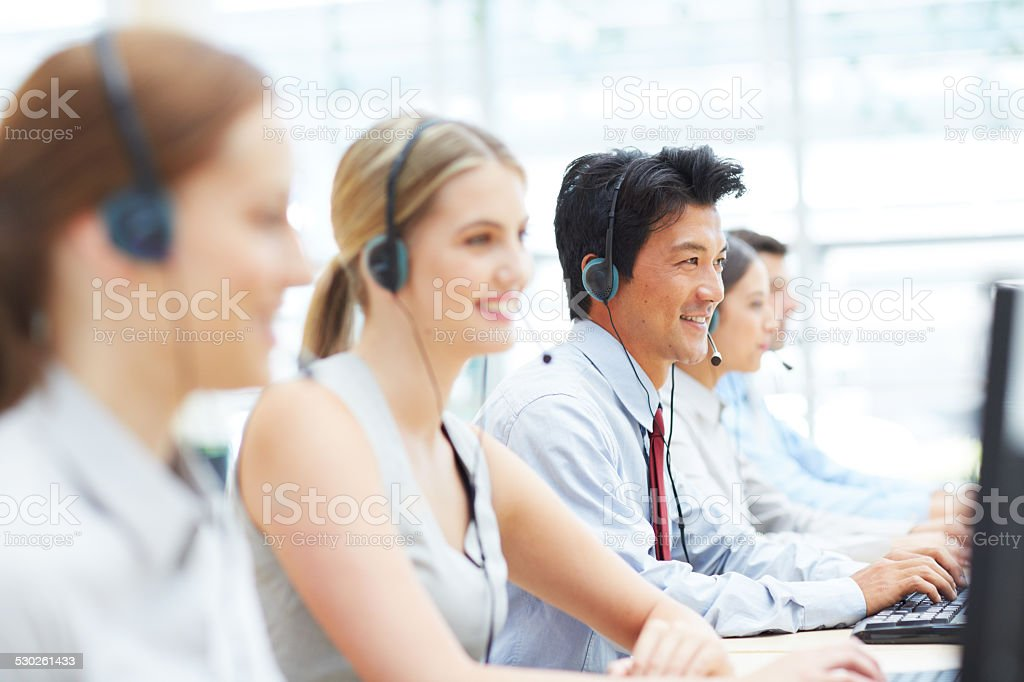 Working hard to help their clients stock photo