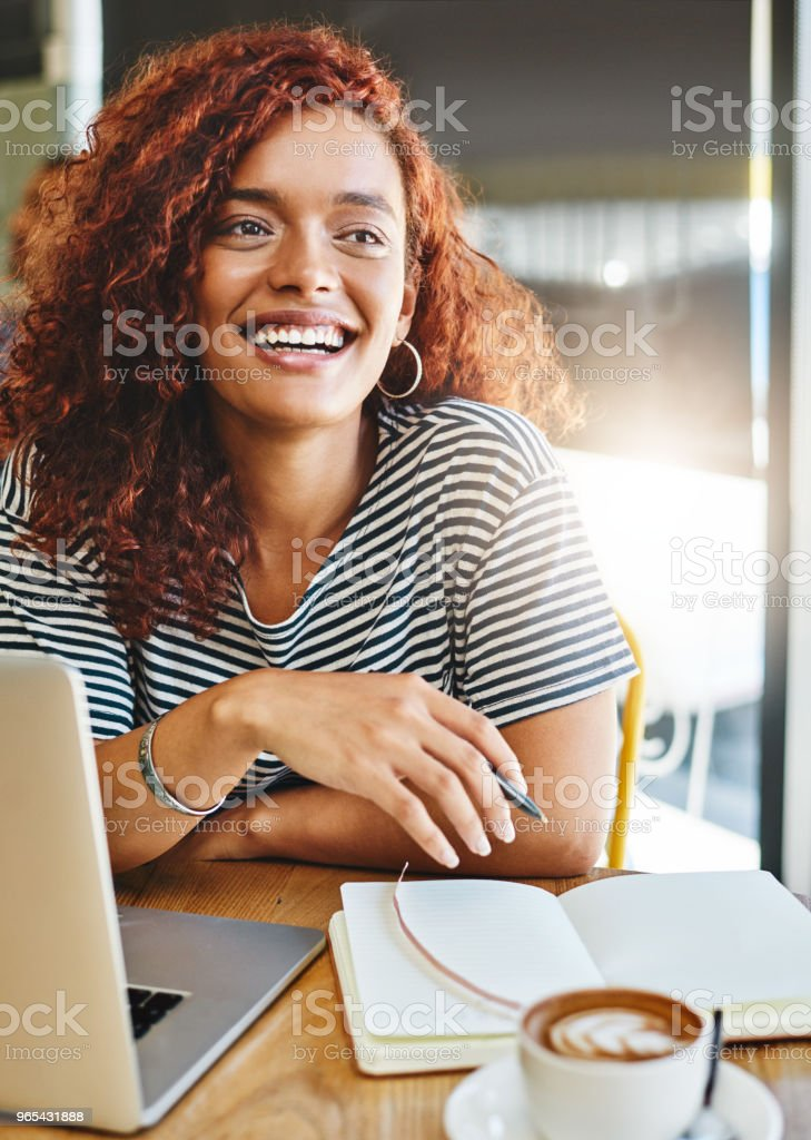 Working hard to make her blog become the best royalty-free stock photo