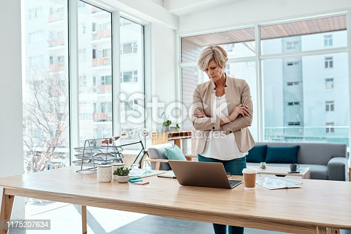 Shot of a mature businesswoman working on a laptop in an office