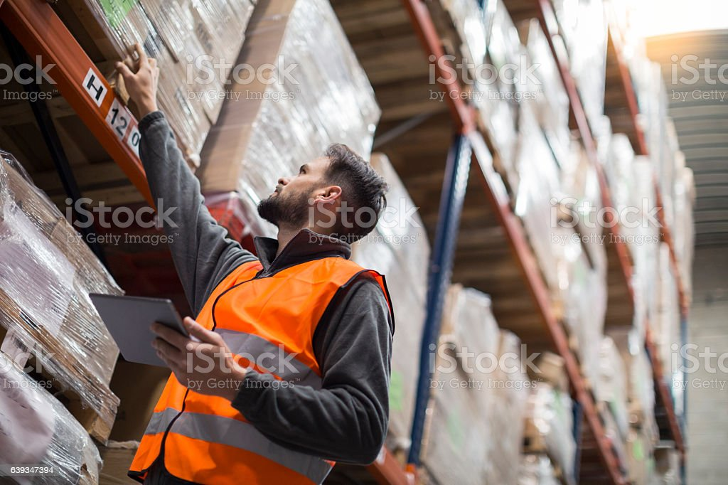 Working hard. Wearhouse workers. stock photo
