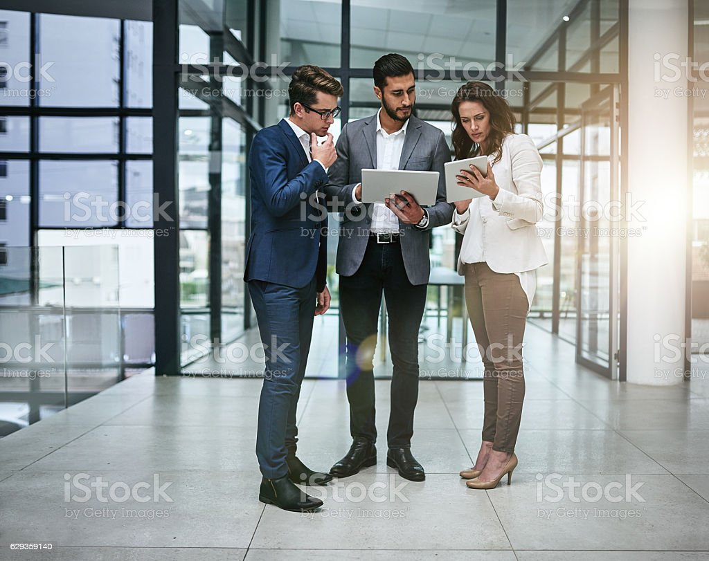 Working harder, working smarter, working together stock photo