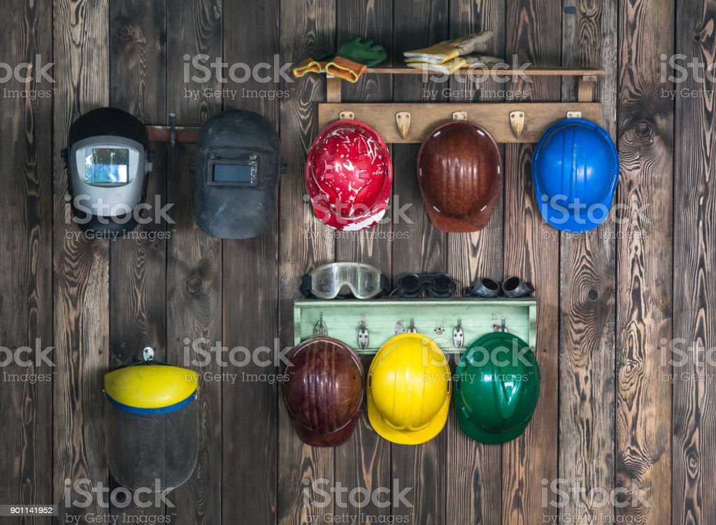 working helmets on the wall stock photo