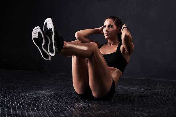working her core - sit ups stock photos and pictures