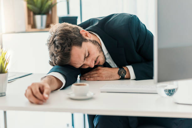 working himself to death - man face down stock pictures, royalty-free photos & images