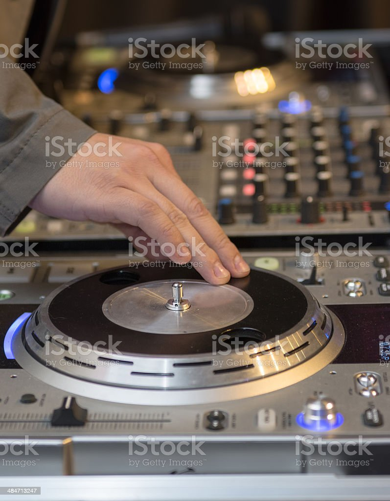 DJ working his console royalty-free stock photo