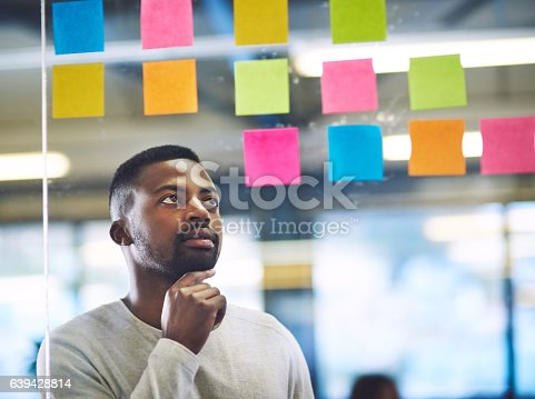 639428672istockphoto Working his way to success with a well constructed plan 639428814