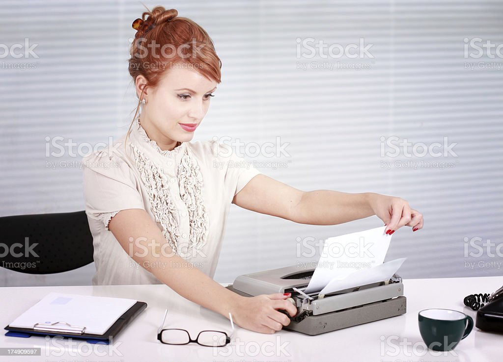 Working hours behind the typewriter royalty-free stock photo