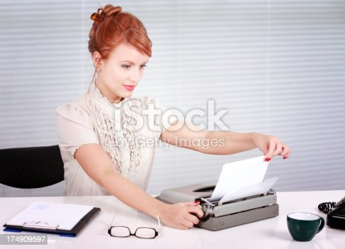 istock Working hours behind the typewriter 174909597