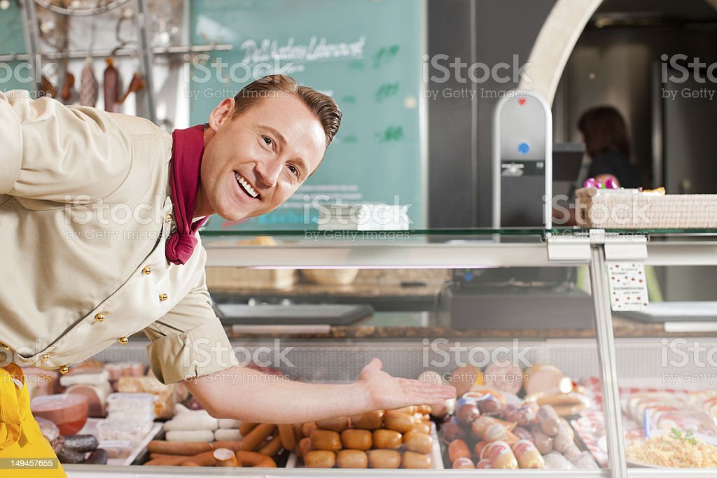 Working in a butcher's shop royalty-free stock photo