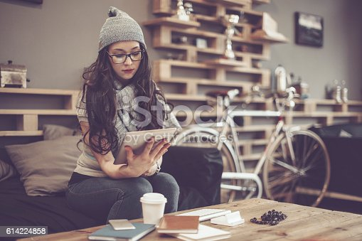 618976144istockphoto Working in a café 614224858