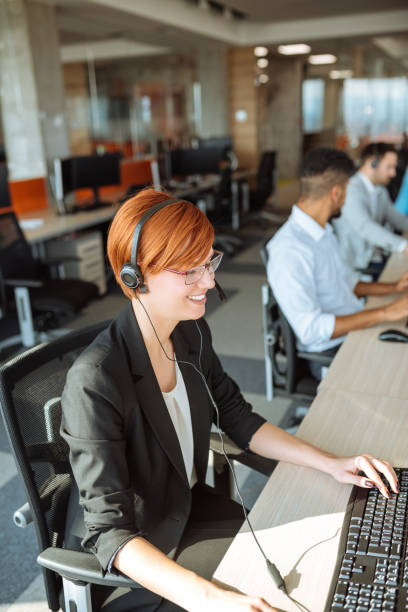 Working in a call centre stock photo