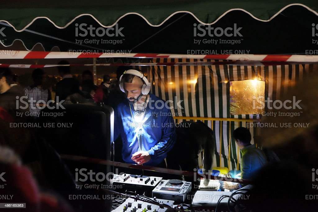 DJ working in a rave royalty-free stock photo