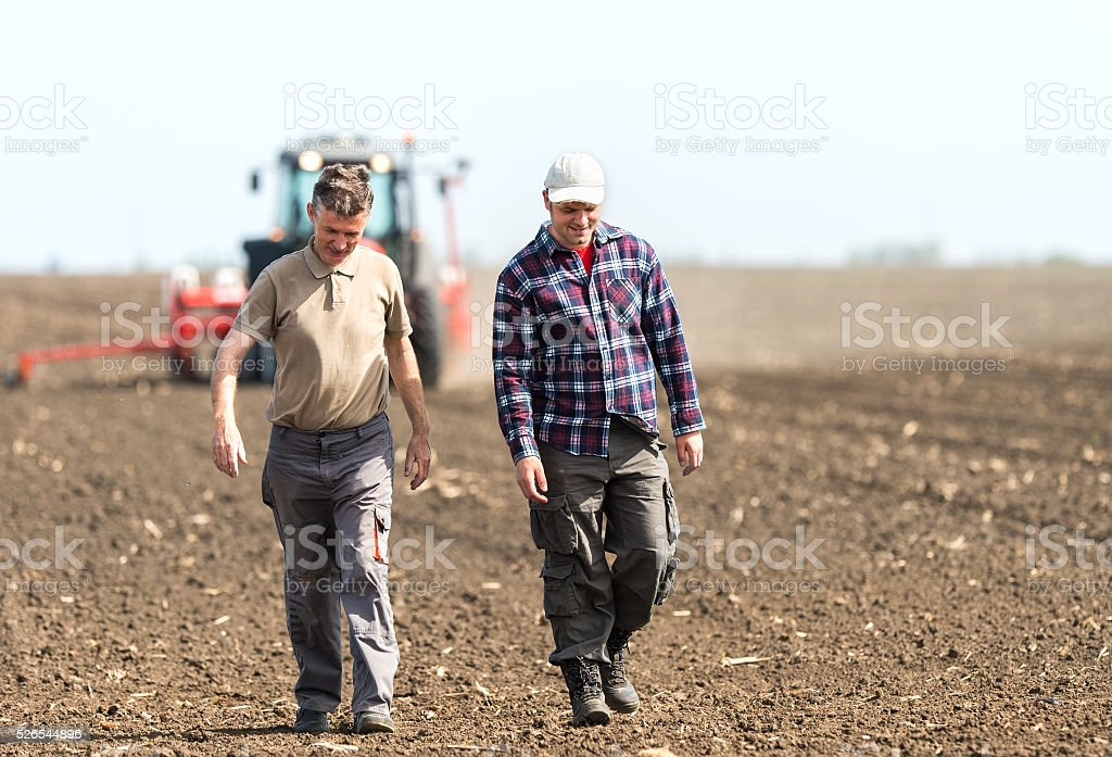 father and son working in agriculture
