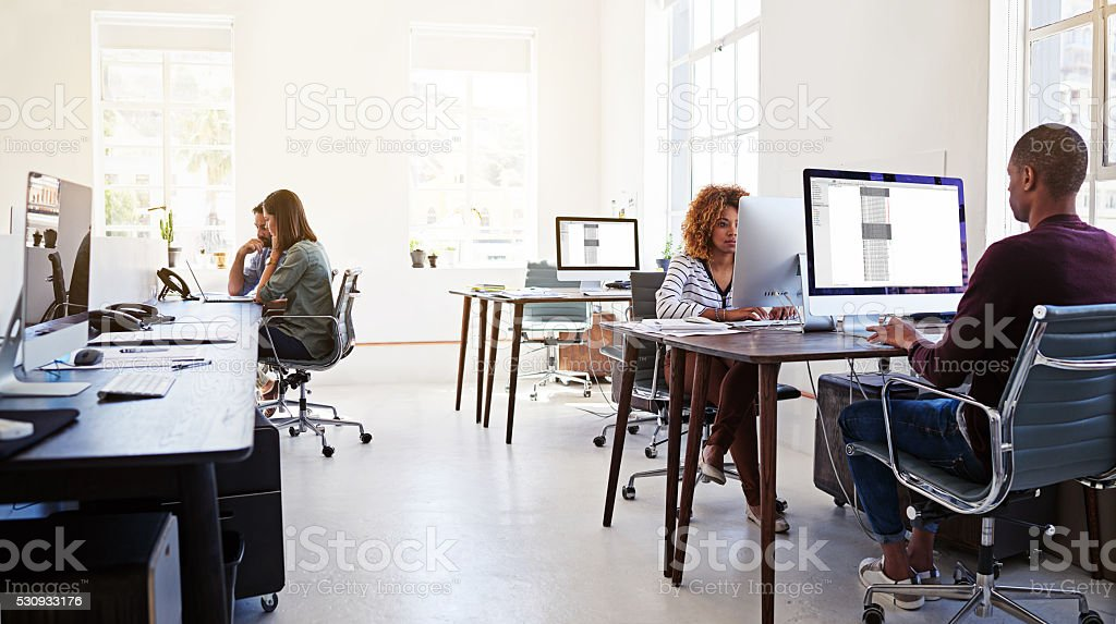 Working in an open plan office stock photo