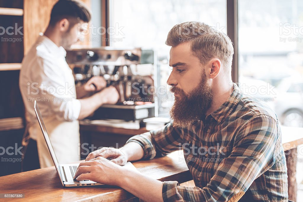 Working in cafe. stock photo