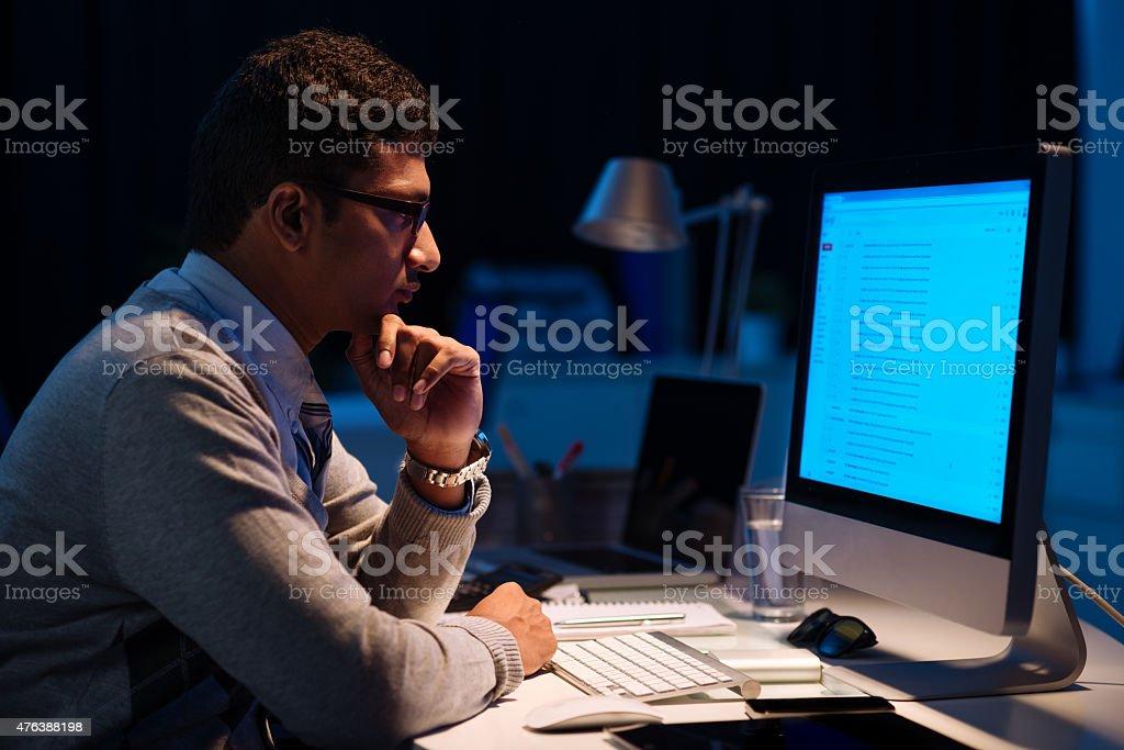 Working in dark office stock photo