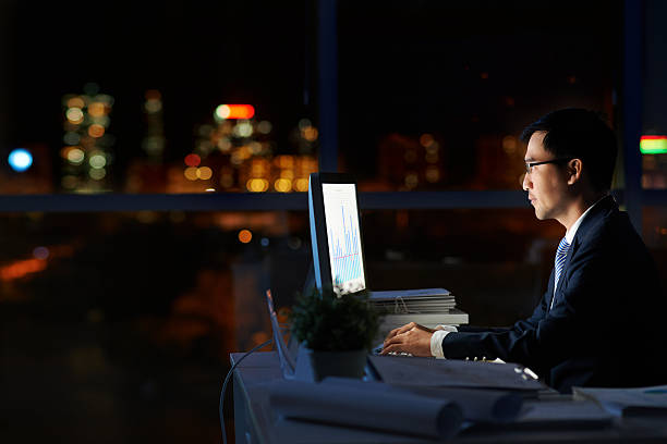Working in darkness stock photo