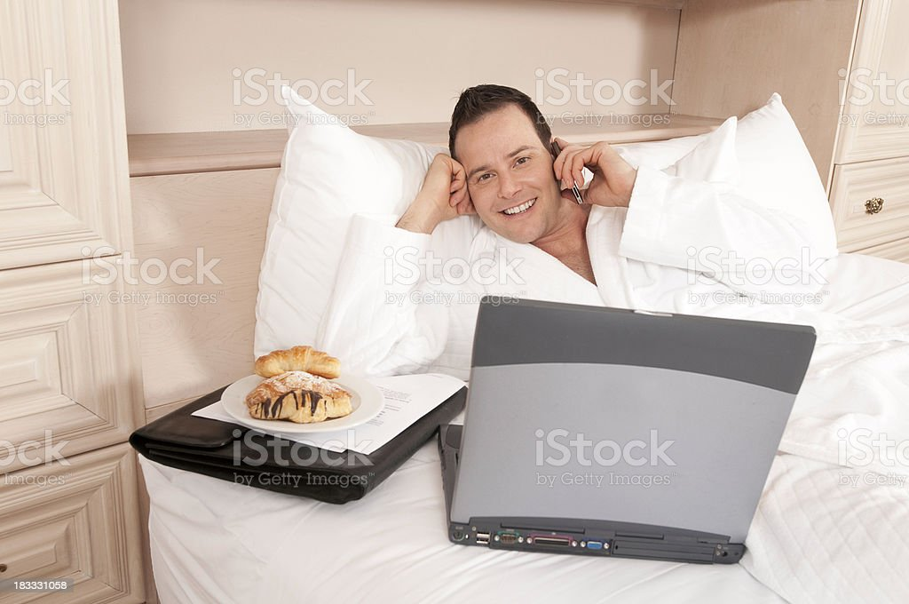 Working in Hotel Room Bed royalty-free stock photo