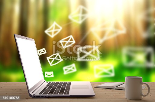 Email letters comming out from an Apple Mac Book Pro laptop screen with blured natural forest on background